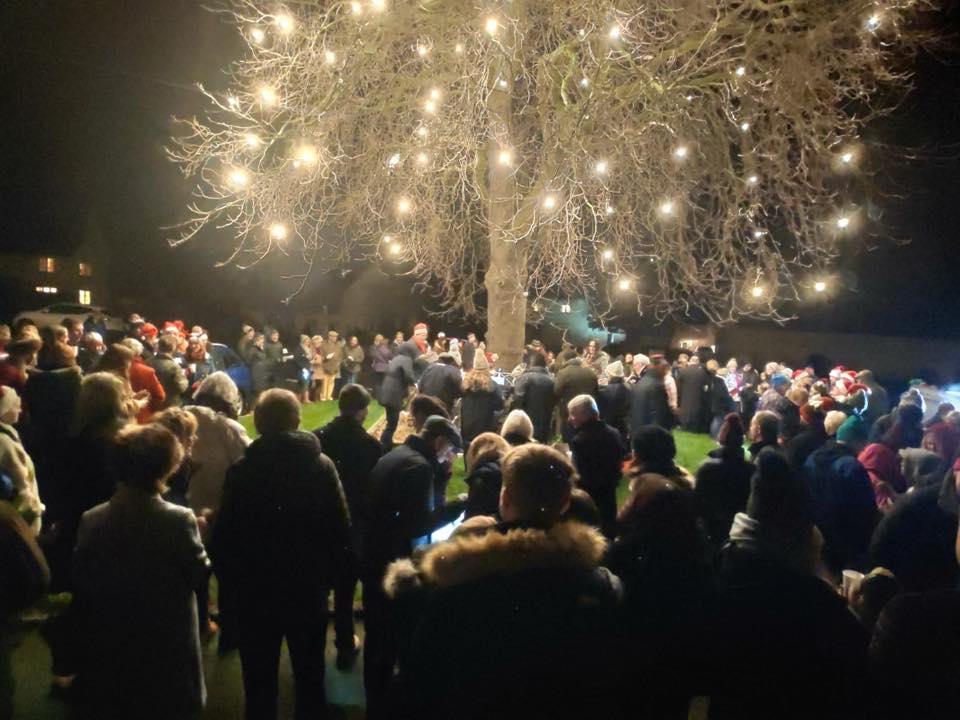 Carols in Willersey under Tree of Light